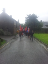 Marching through the village of Edale