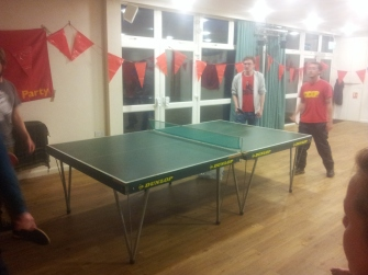 Hotly contested game of table tennis doubles before the Saturday night dinner and social!