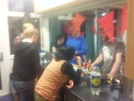 Busy bar service at the Saturday night social