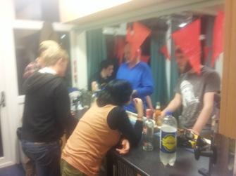 Busy bar service at the Saturday night social